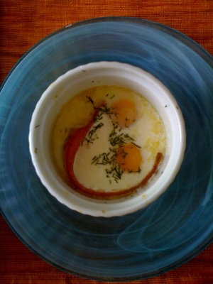 Baked eggs with bacon and dill